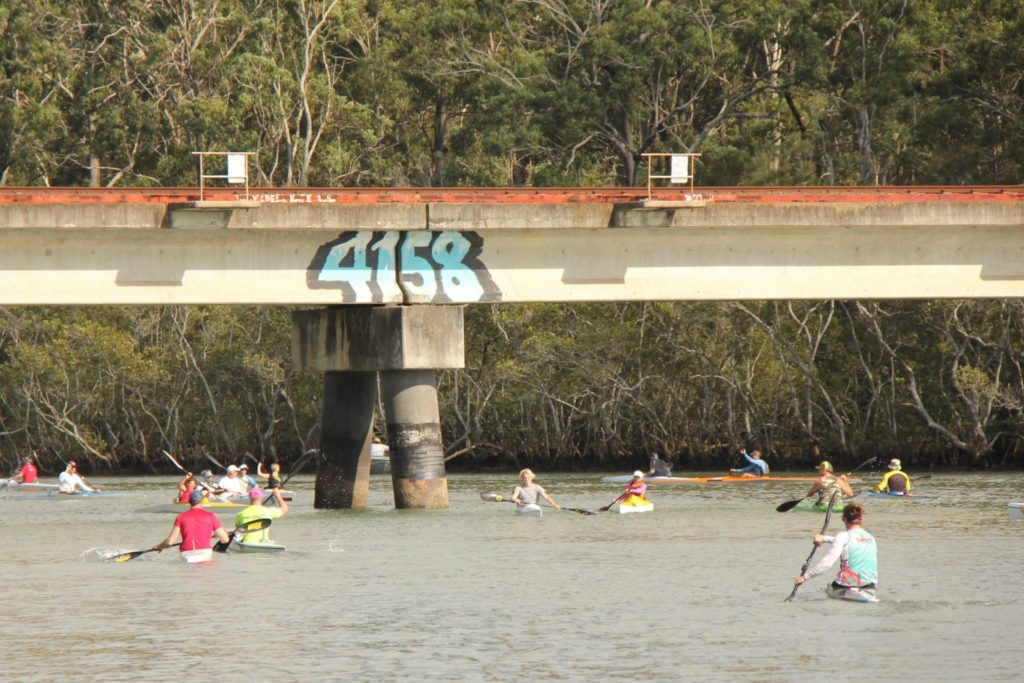 Thorneside Classic 2019 - rail bridge with many paddlers on the water