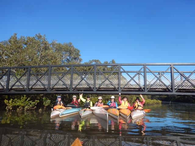 WRCC members in their kayaks under the cycle bridge across Lota Creek